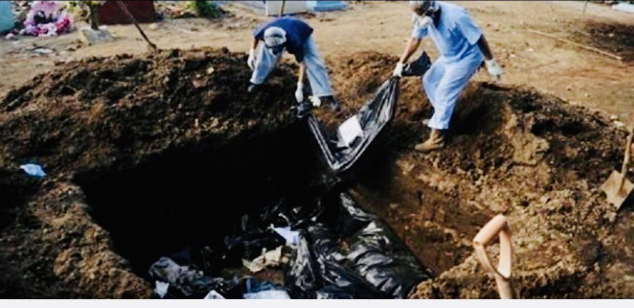 découverte d'une grande fosse commune de victimes du génocide